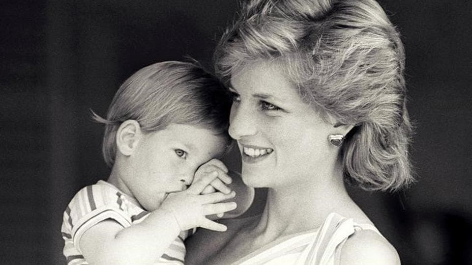 Britain's Princess Diana holds Prince Harry during a morning picture session at Marivent Palace, where the Prince and Princess of Wales are holidaying as guests of King Juan Carlos and Queen Sofia, in Mallorca, Spain August 9, 1988.  Never before seen images of Diana, Princess of Wales with princes William  and  young Prince Harry were revealed for the first time ahead of the 20th anniversary of her death. (Reuters )