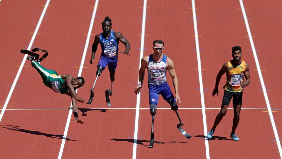 Ntando Mahlangu of South Africa falls during a heat of the men's 100 metre. The World Para Athletics Championships, earlier known as the IPC Athletics World Championships, is a biennial Paralympic athletics event organized by a subcommittee of the International Paralympics Committee. (Henry Browne / REUTERS)