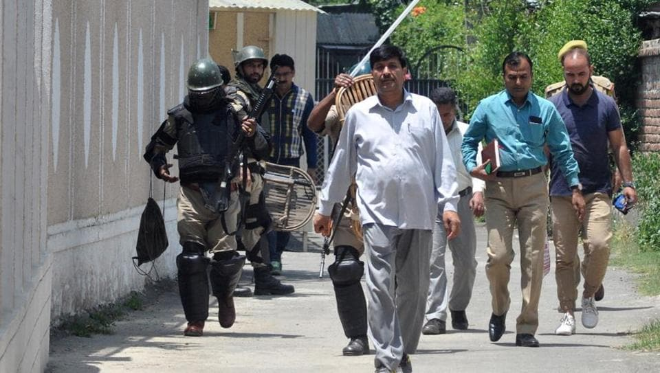 An NIA team carries out  a raid in Srinagar in June.
