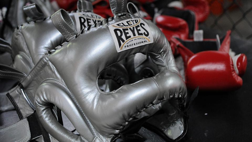 Protective training headgear and boxing gloves are pictured at Reyes Industries headquarters in Mexico City. (Bernardo Montoya / AFP)
