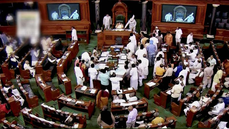 A view of the Lok Sabha as opposition members protest during the ongoing monsoon session of Parliament. (PTI Photo)