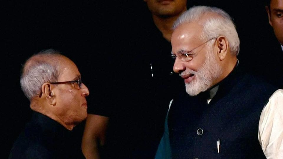 President Pranab Mukherjee and Prime Minister Narendra Modi exchange greetings at the release of the special book
