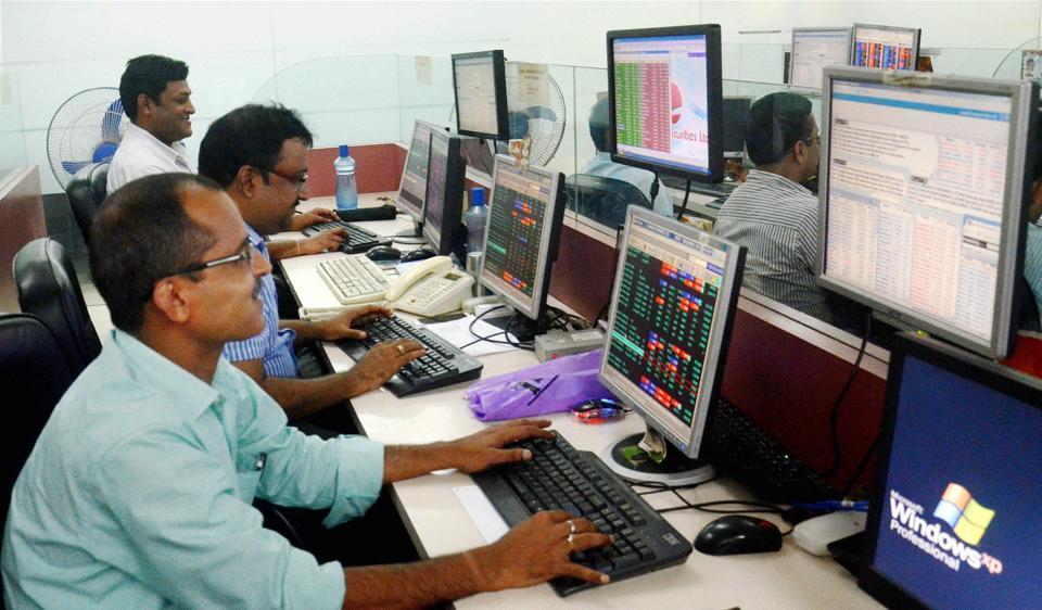 Brokers & shareholders at Kolkata share market react as Sensex and Nifty gain after opening on Monday.