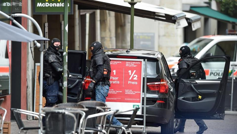 Swiss police are seen in the old quarter of Schaffhausen, northern Switzerland on July 24, 2017, after a man armed with a chainsaw injured at least five people in an attack.