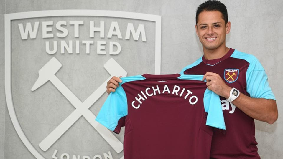 Javier Hernandez poses with the team jersey after her move to West Ham United.