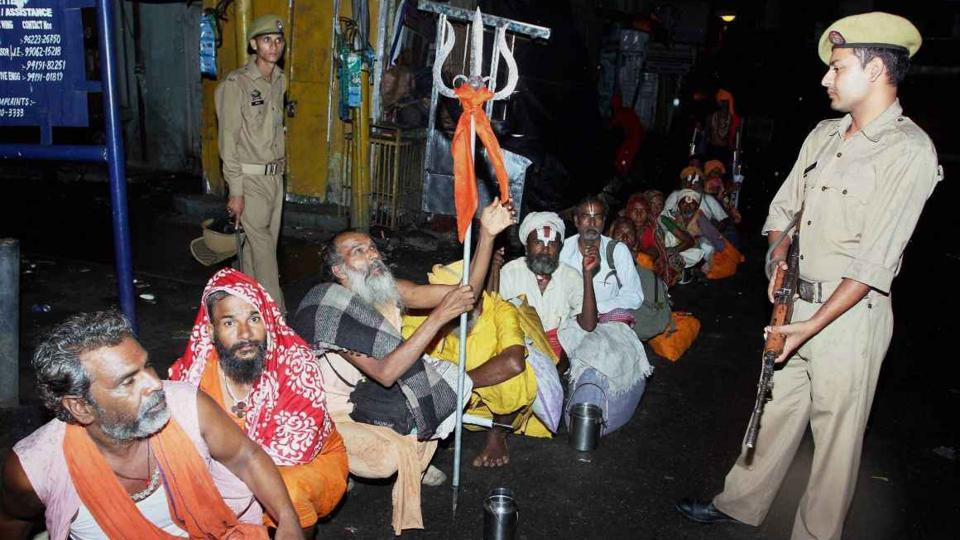 Security personnel keeping a vigil as sadhus gather to head towards Kashmir to pay obeisance at the Amarnath shrine cave, days after militant attack on pilgrims in Anantnag.
