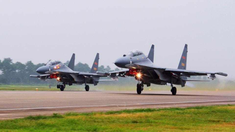 Two Chinese fighter jets intercepted a US Navy surveillance plane over the East China Sea over the weekend.