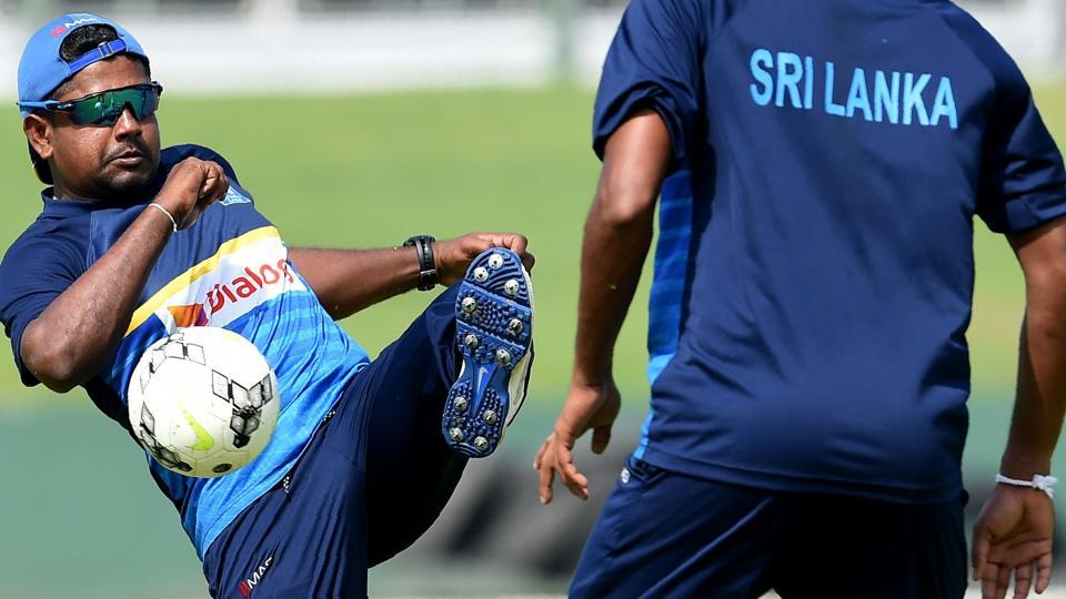 Sri Lanka cricket captain Rangana Herath (L) and Suranga Lakmal play football during a training session at Galle International Cricket Stadium on Tuesday. The first Test between SL and Indian cricket team will begin on Wednesday.