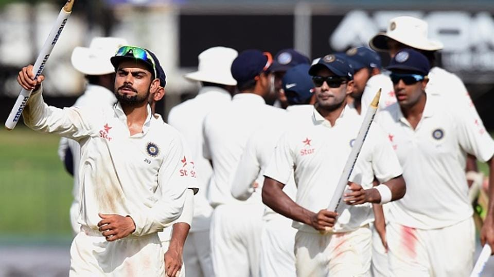 Indian cricket team skipper Virat Kohli celebrates with teammates after beating Sri Lanka cricket team on the final day of the third Test against at the Sinhalese Sports Club (SSC) in Colombo on September 1, 2015. With the win, the Kohli-led Indian side broke a hoodoo by winning a Test series in Sri Lanka for the first time since 1993.