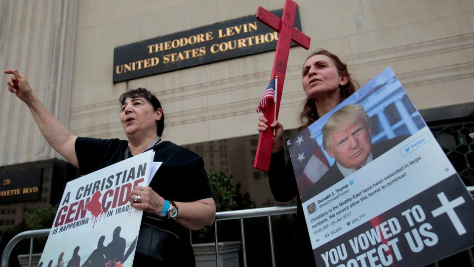 Protesters rally outside the federal court just before a hearing to consider a class-action lawsuit filed on behalf of Iraqi nationals facing deportation, in Detroit, Michigan, US, on June 21, 2017.