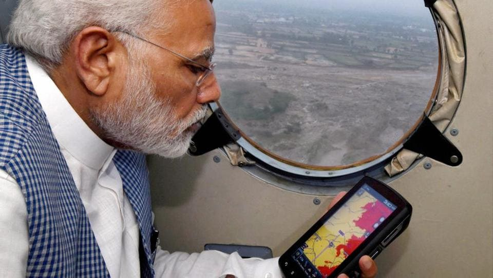 Prime Minister Narendra Modi conducting an aerial survey of flood affected areas of Banaskatha districts of Gujarat on Tuesday.