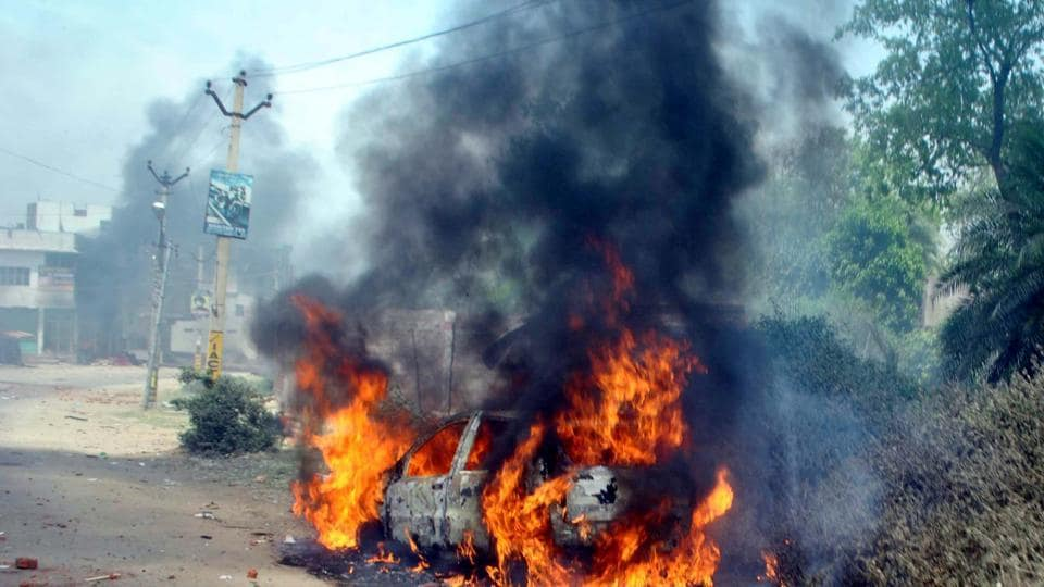 A car set on fire by rioters during communal violence in Hazaribagh in April, 2016.
