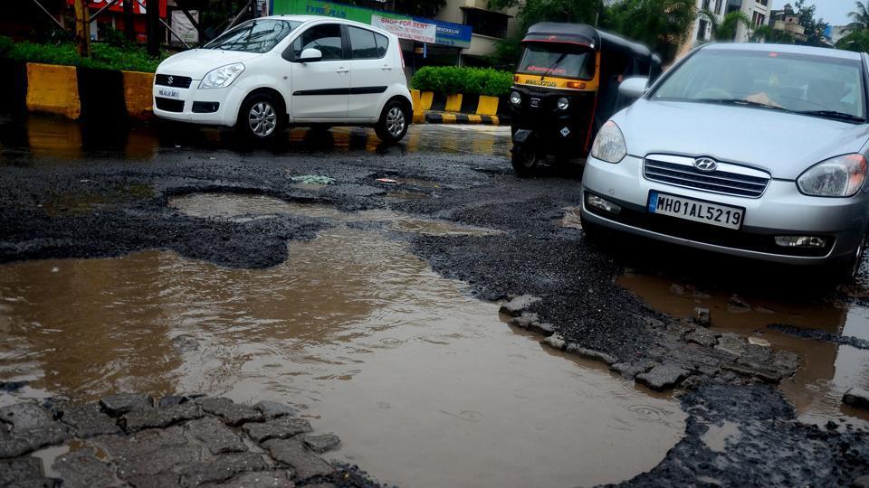 pothole,Mumbai biker,public anger