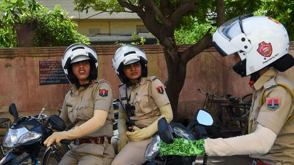 Members of the female police patrol unit drive through the old city in Jaipur.