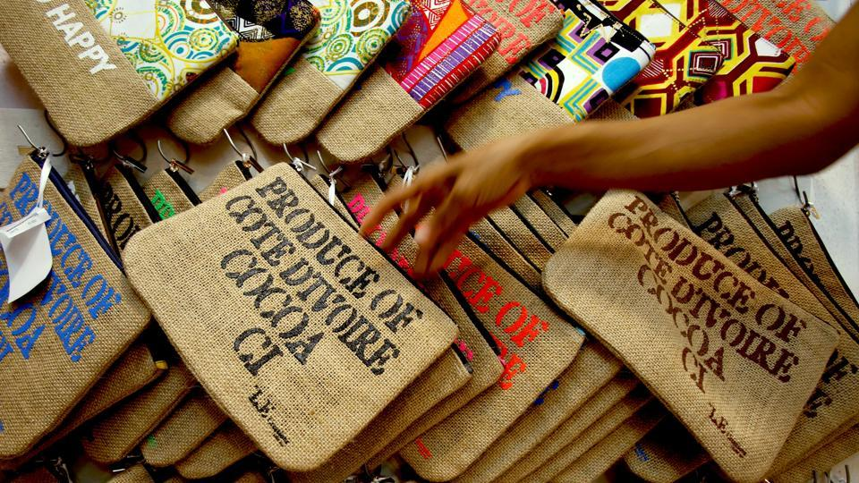 The bags have the words 'Produce of Cote d'Ivoire - Cocoa' written on them.