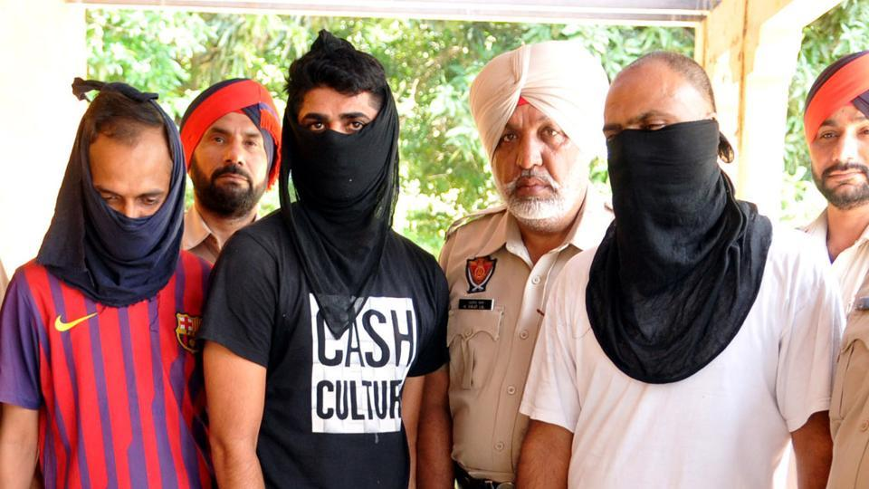 Police officials presenting the arrested members of the inter-state gang of ATM looters in Jalandhar on Tuesday, July 25.