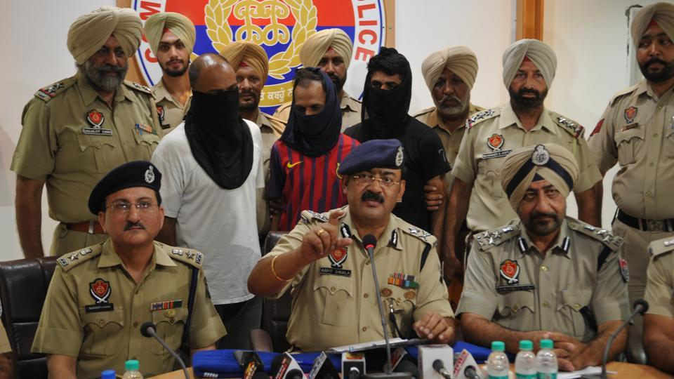 IGP Arpit Shukla and other police officials presenting the three arrested men in Jalandhar on Tuesday, July 25.