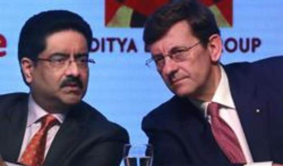 Aditya Birla Group chairman, Kumar Mangalam Birla, left, talks with Vodafone Group CEO Vittorio Colao, during a press conference in Mumbai after the British telecom company Vodafone's Indian unit announced a merger with Idea Cellular, creating the country's largest telecom operator with nearly 400 million customers.