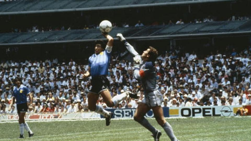 Argentina's Diego Maradona scores first goal with his Hand of God, past England goalkeeper Peter Shilton in 1986 World Cup quarterfinal in Mexico
