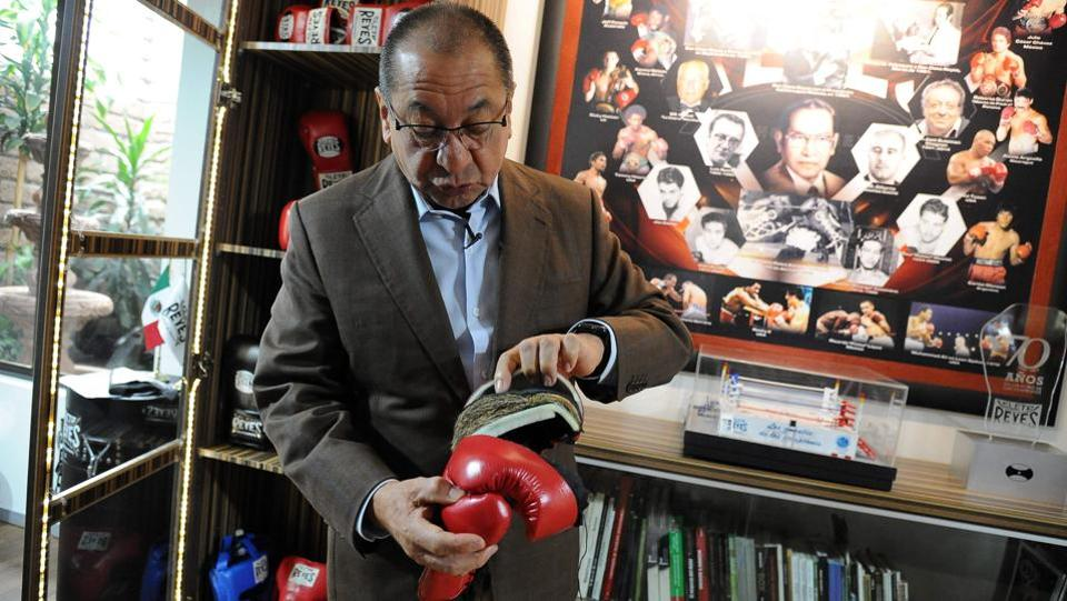Alberto Reyes, son of Cleto Reyes founder of the iconic Mexican boxing gloves factory which bears his name, explains the production process at Reyes Industries headquarters in Mexico City. (Bernardo Montoya / AFP)