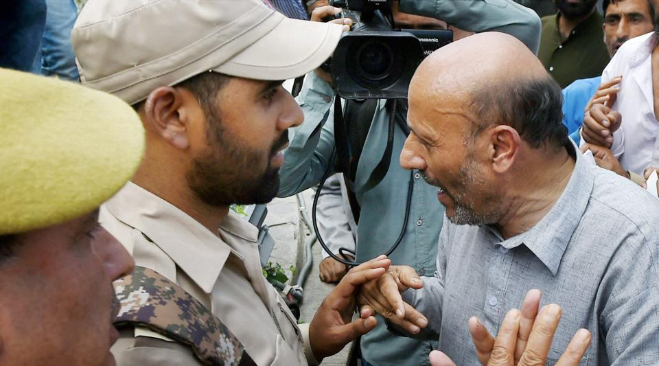 Police detain MLA Abdul Rashid Sheikh after he tried to stage a protest against army personnel, in Srinagar on July 24.