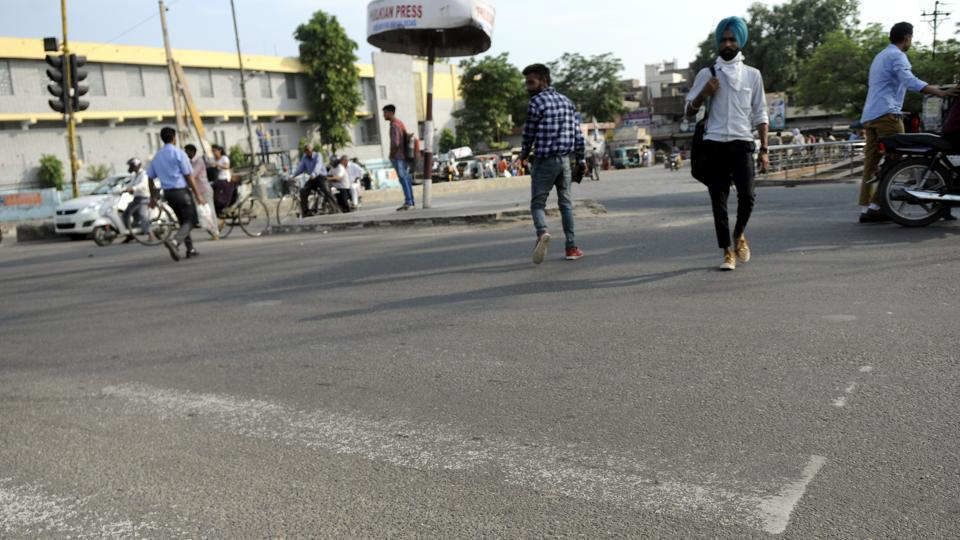 Remnants of zebra lines near the bus stand in Patiala on Tuesday, July 25.