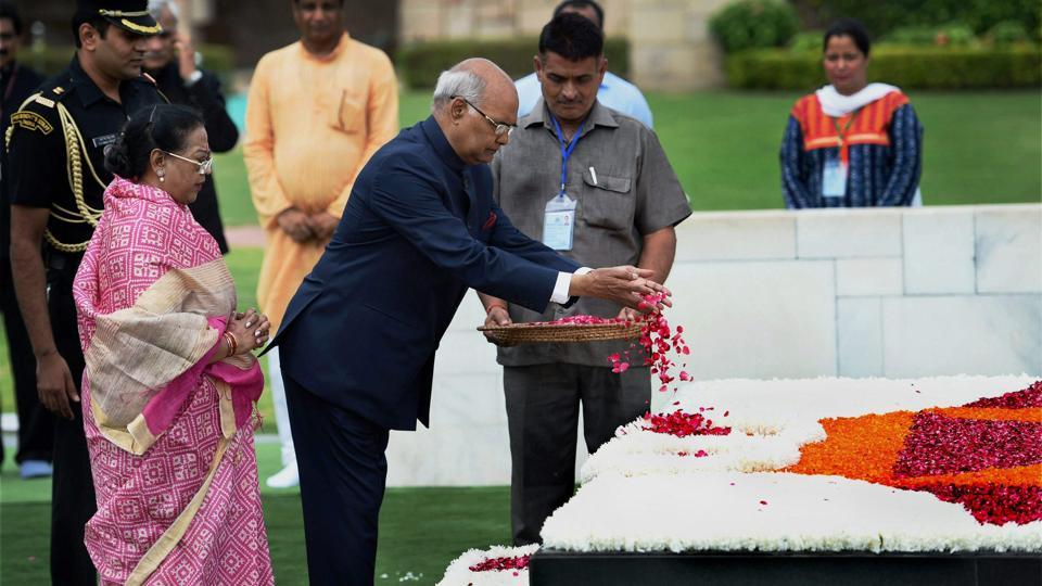 President-elect Ram Nath Kovind with his wife pays floral tributes to Mahatma Gandhi at Rajghat. (PTI)