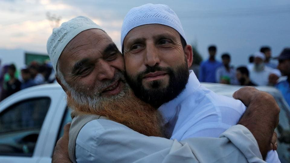 A Muslim pilgrim (right) is hugged by a relative before leaving for the annual Haj pilgrimage to the holy city of Mecca, in Srinagar on Tuesday.