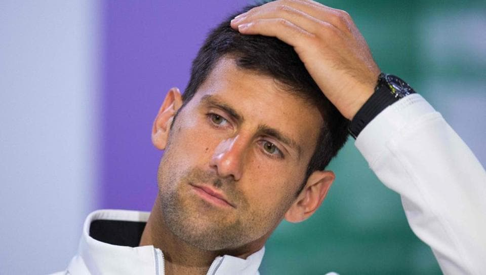 Serbia's Novak Djokovic speaks during a press conference at The All England Tennis Club in Wimbledon.