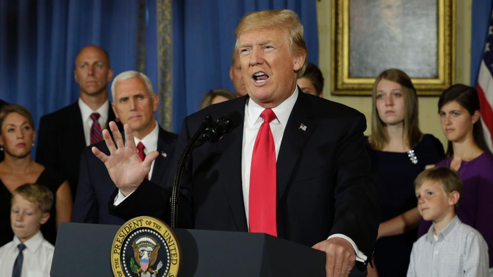 US President Donald Trump delivers s statement on healthcare in front of alleged