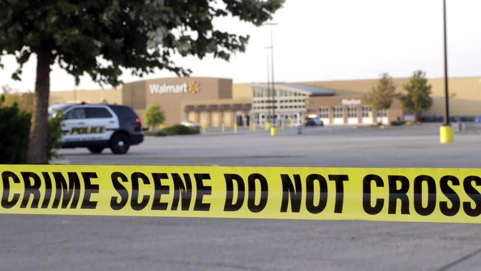 San Antonio police officers investigate the scene where eight people were found dead in a tractor-trailer loaded with at least 30 others outside a Walmart store on July 23.