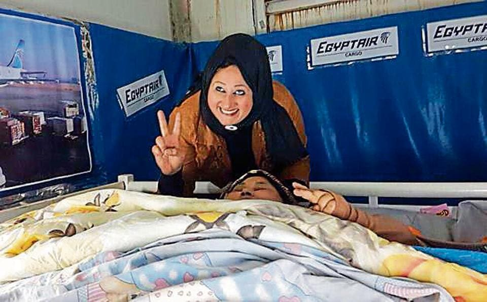 Shaimaa Ahmed, the sister of the world's heaviest women Eman Abdellatif, who weighted close to 500 kg before surgery, shows a victory sign on their way to Mumbai's Saifee Hospital for Eman's weight-loss surgery earlier this year