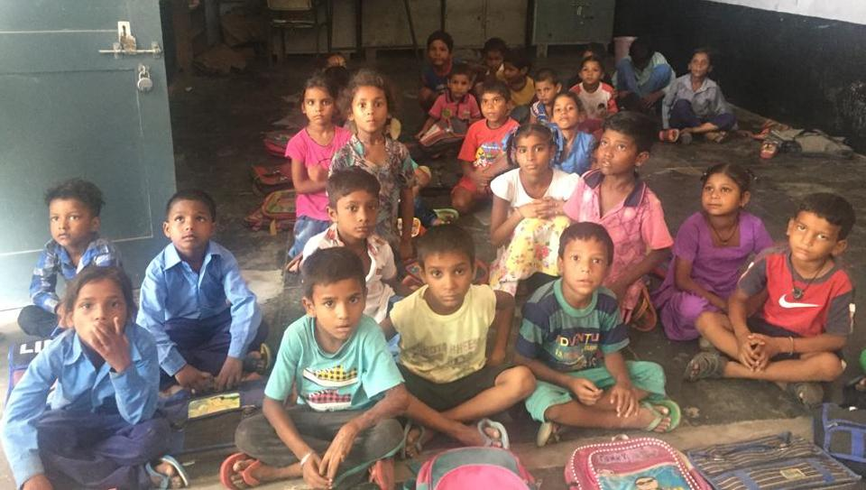 Students sitting on the floor in Government Primary School, Jeevan Nagar, Faridkot.
