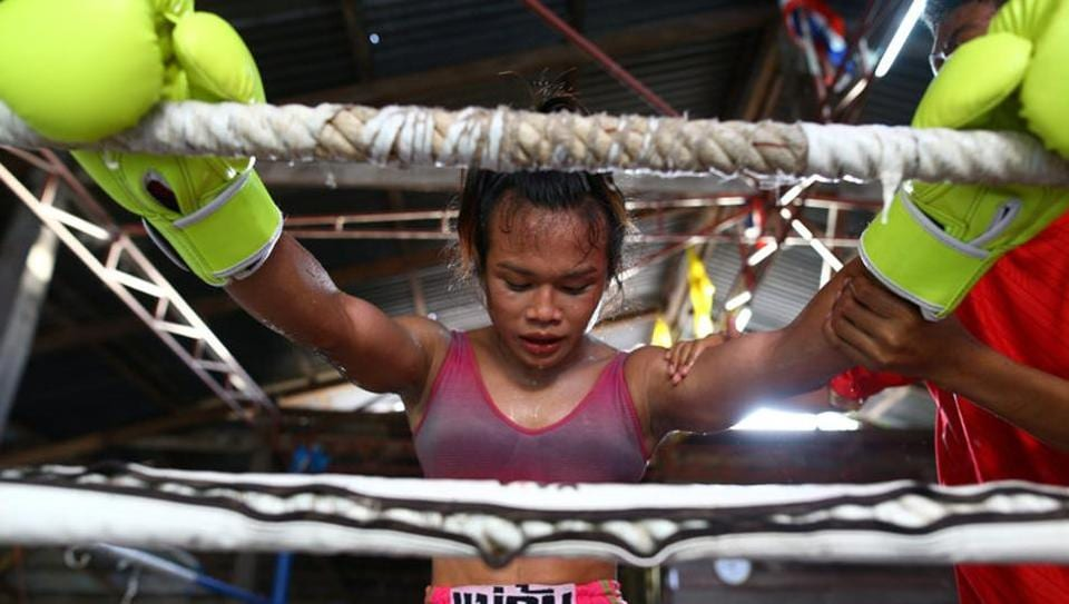 Muay Thai boxer Nong Rose Baan Charoensuk, trains at a gym in Buriram province, Thailand. The 21-year-old started boxing at eight, following in the footsteps of an uncle, a Muay Thai fighter who encouraged her to train. Her twin brother is also a Muay Thai fighter. (Athit Perawongmetha / REUTERS)