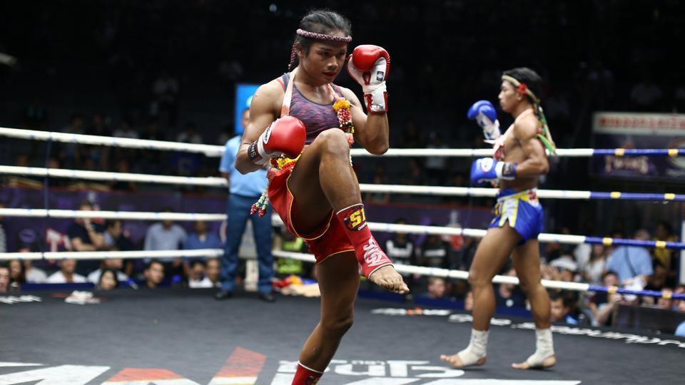 Clad in a pink tank top and shorts, her face made up with rouge and red lipstick, transgender Muay Thai fighter Nong Rose Baan Charoensuk is a formidable opponent. (Athit Perawongmetha  / REUTERS)