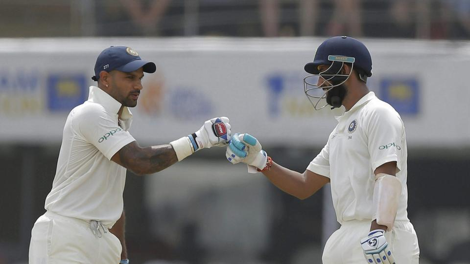 Powered by centuries from Cheteshwar Pujara(R)and Shikhar Dhawan, India reached 399/3 onDay 1 of the first Test Sri Lanka at Galleon Wednesday. (AP)