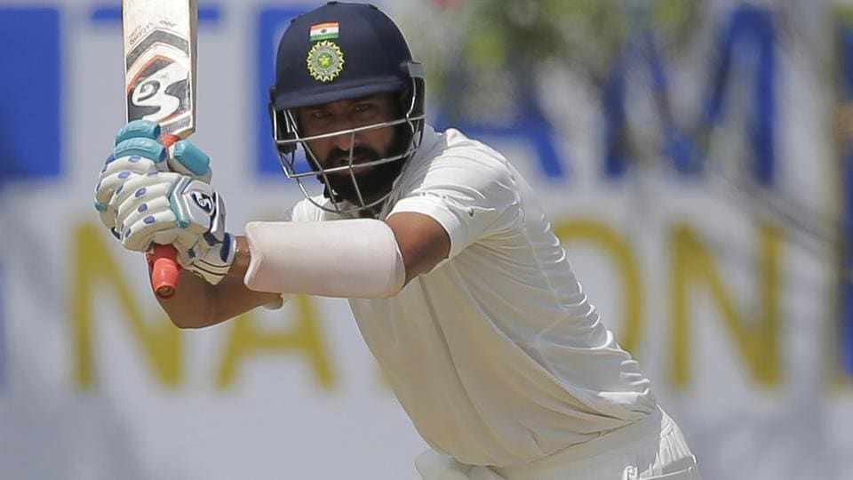 Cheteshwar Pujara gave good support to Dhawan from the other end. (AP)