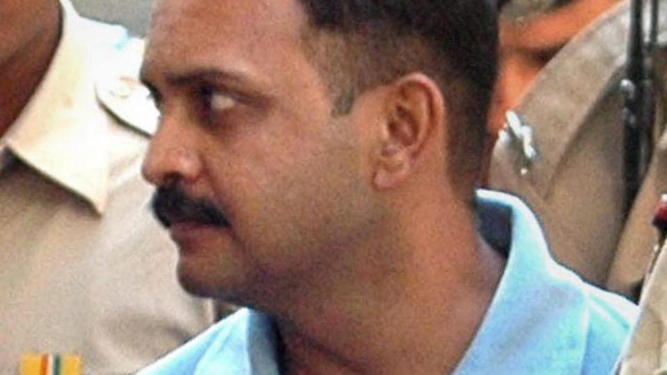 Malegaon blast accused Lt Col Prasad Purohit being taken to a sessions court in Mumbai.