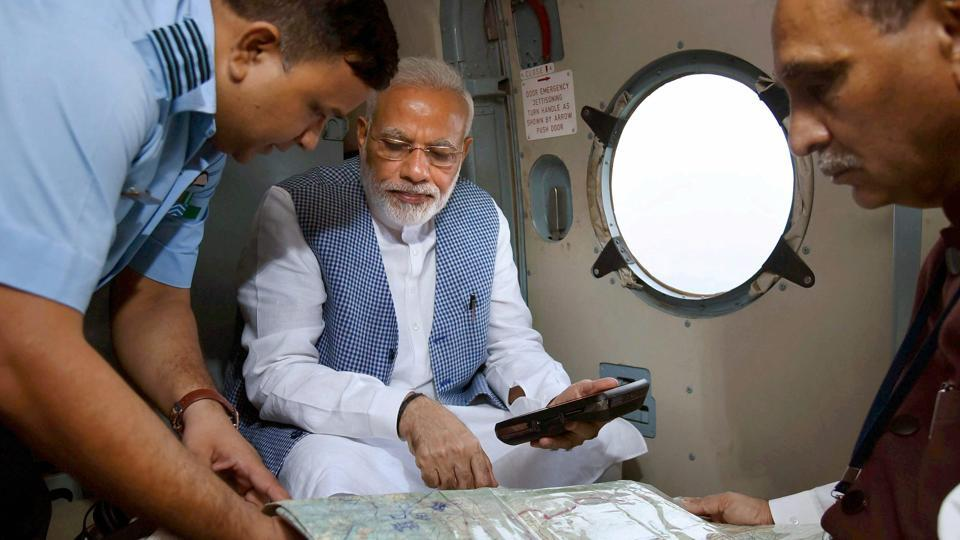 Prime Minister Narendra Modi with Gujarat chief minister Vijay Rupani during an aerial survey of flood-affected areas of Banaskatha district of Gujarat on Tuesday.