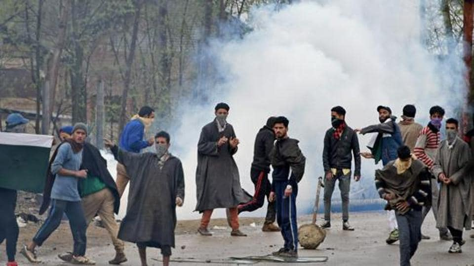 A group of youngsters pelt stones at security forces during an anti-militant operation in Kashmir's Budgam district.