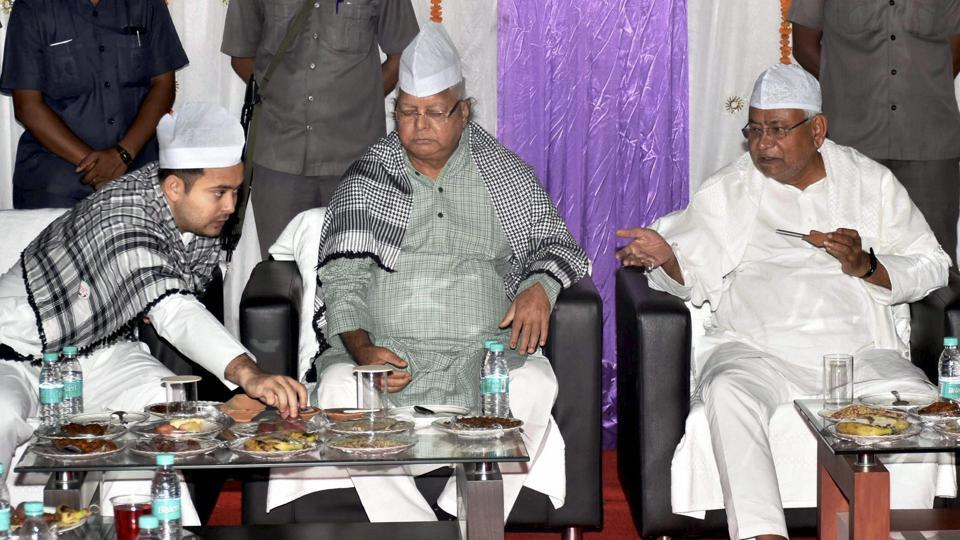 Bihar chief minister Nitish Kumar with RJD chief Lalu Prasad and deputy CM Tejashwi Yadav during a Roza-Iftaar party in Patna on June 19, 2017.