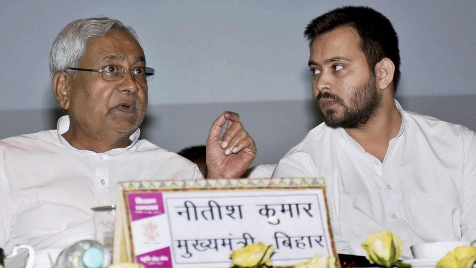 Bihar Chief Minister Nitish Kumar with Deputy CM Tejashwi Yadav during inauguration of 'Kisan Samagam' at Gyan Bhawan in Patna on June 16, 2017.