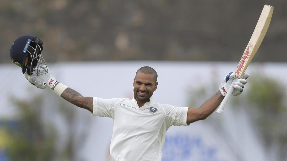 India's Shikhar Dhawan celebrates scoring a century during the first dayof the first Test against Sri Lanka in Galle on Wednesday.