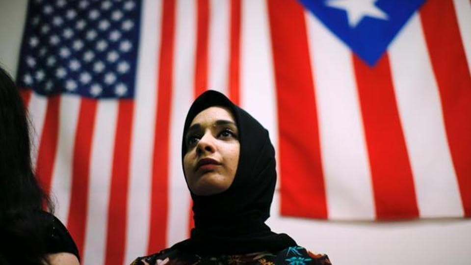 A woman attends a town hall meeting following a rally to protest restrictive guidelines issued by the US on who qualifies as a close familial relationship under the Supreme Court order on the Muslim and refugee ban at Union Square on June 29, 2017, in New York.