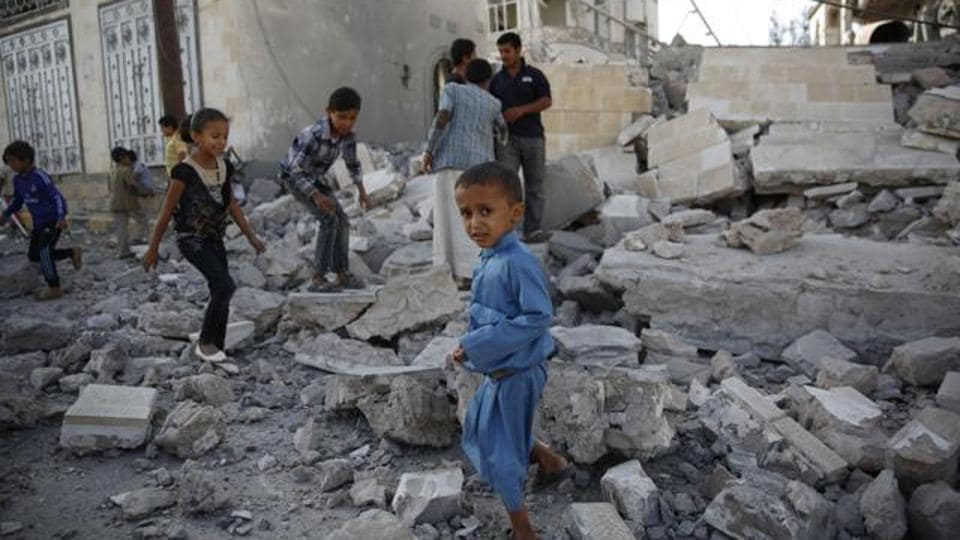 FILE -- In this Sept. 8, 2015 file photo, children play amid the rubble of a house destroyed by a Saudi-led airstrike in Sanaa, Yemen. Hunger has been the most horrific consequence of Yemen's conflict and has spiraled since Saudi Arabia and its allies, backed by the U.S., launched a campaign of airstrikes and a naval blockade a year ago.