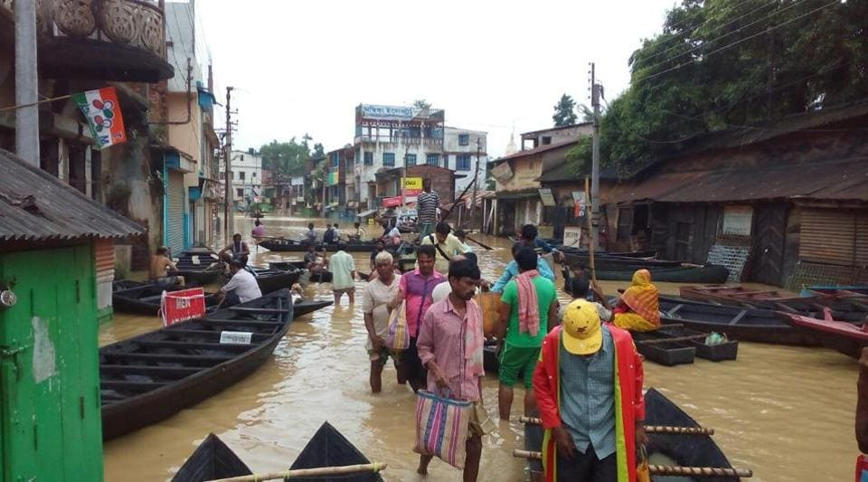 Boats carrying people inside Ghatal town in West Midnapore on Thursday after the roads were inundated.