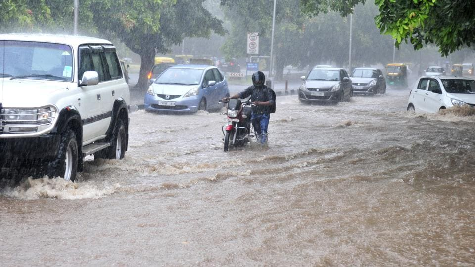 Motorist faced a harried time after heavy rains lashed Chandigarh on Thursday. (Ravi Kumar/HT Photo)