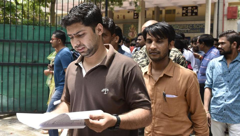 Candidates come out after appearing for the UPSC Civil Services Preliminary Exam 2017 in New Delhi on June 18.