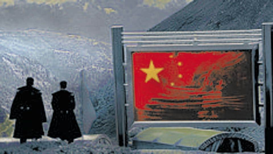 PLA officers on the Chinese side of the international border at Nathula Pass along the border with of Sikkim.