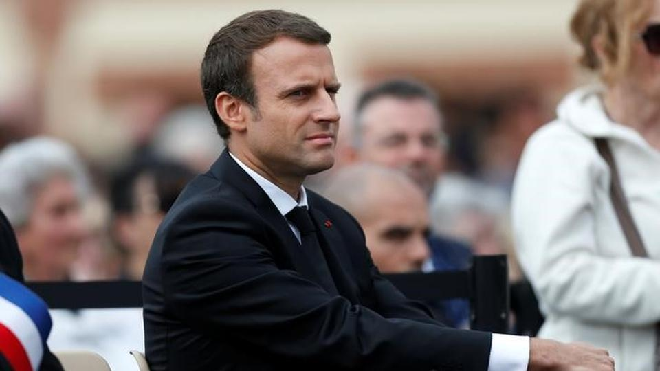 French President Emmanuel Macron listens to speeches after a mass to pay tribute to French priest Father Jacques Hamel one year after he was killed by Islamist militants in an attack in the church, in Saint-Etienne-du-Rouvray near Rouen, France.